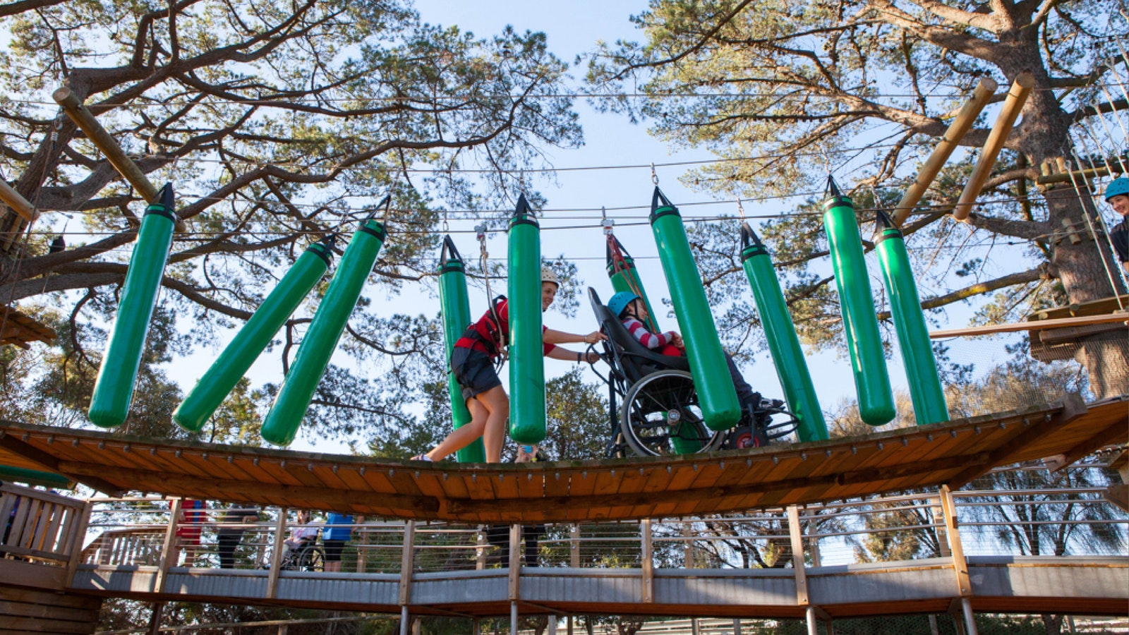 image: boy in wheelchair enjoying accessible ropes course