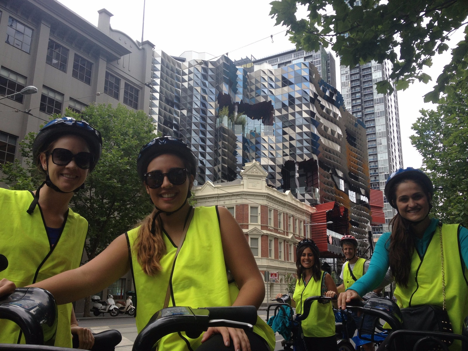 bike riders in front of Swanston Academic Building