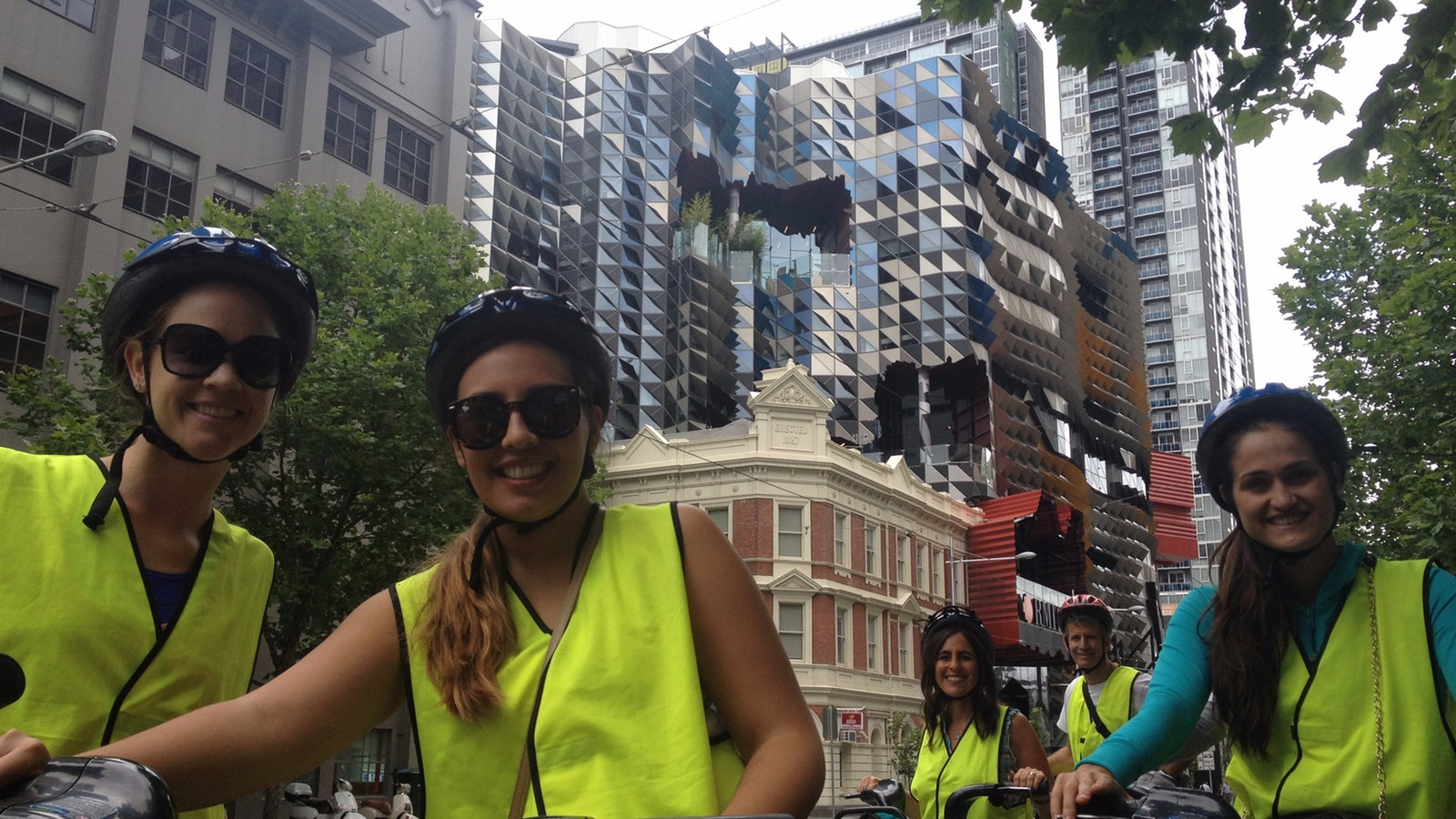riders in front of Swanston Academic Building
