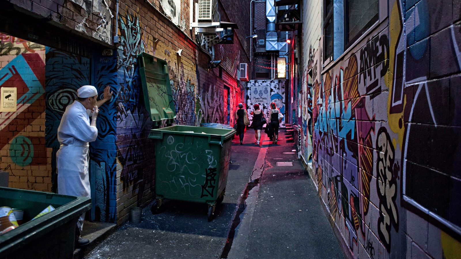 Three women walk towards a night club in Croft Alley, Jaime Murcia