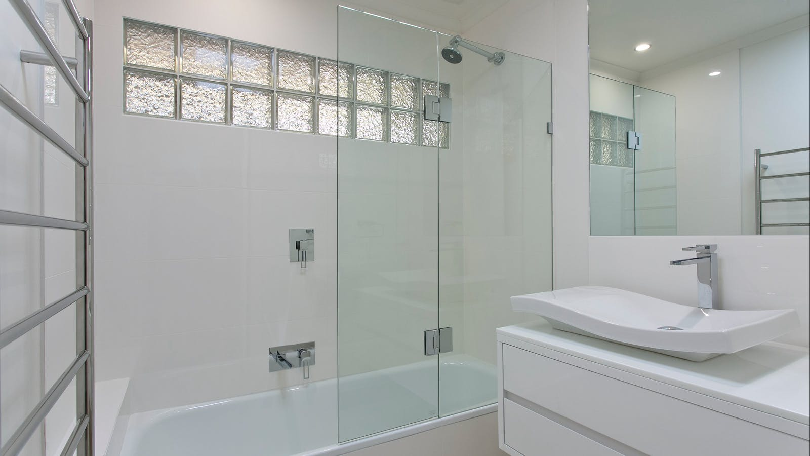 Modern bathroom with shower and bath.