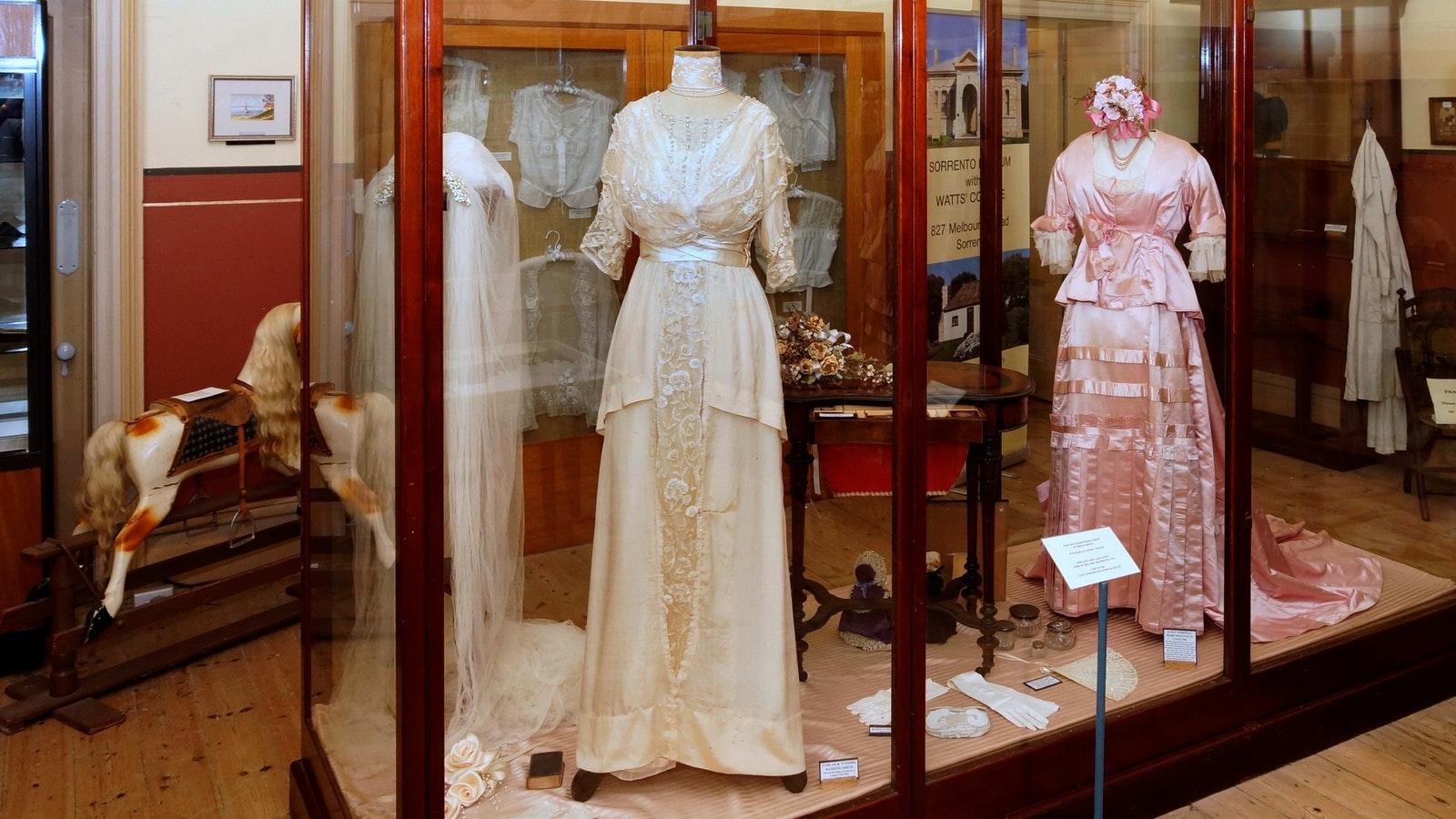 Beautiful old ladies' long dresses, including a cream wedding dress and black taffeta day dress