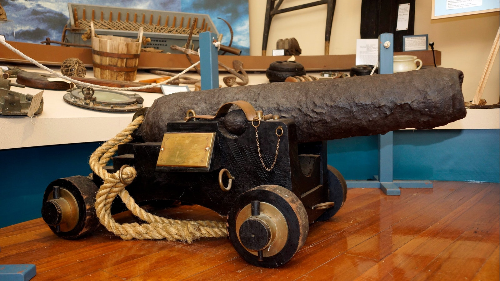 Craigburn Cannon - two and a half feet long gun barrel mounted on wheels, with round cannon balls