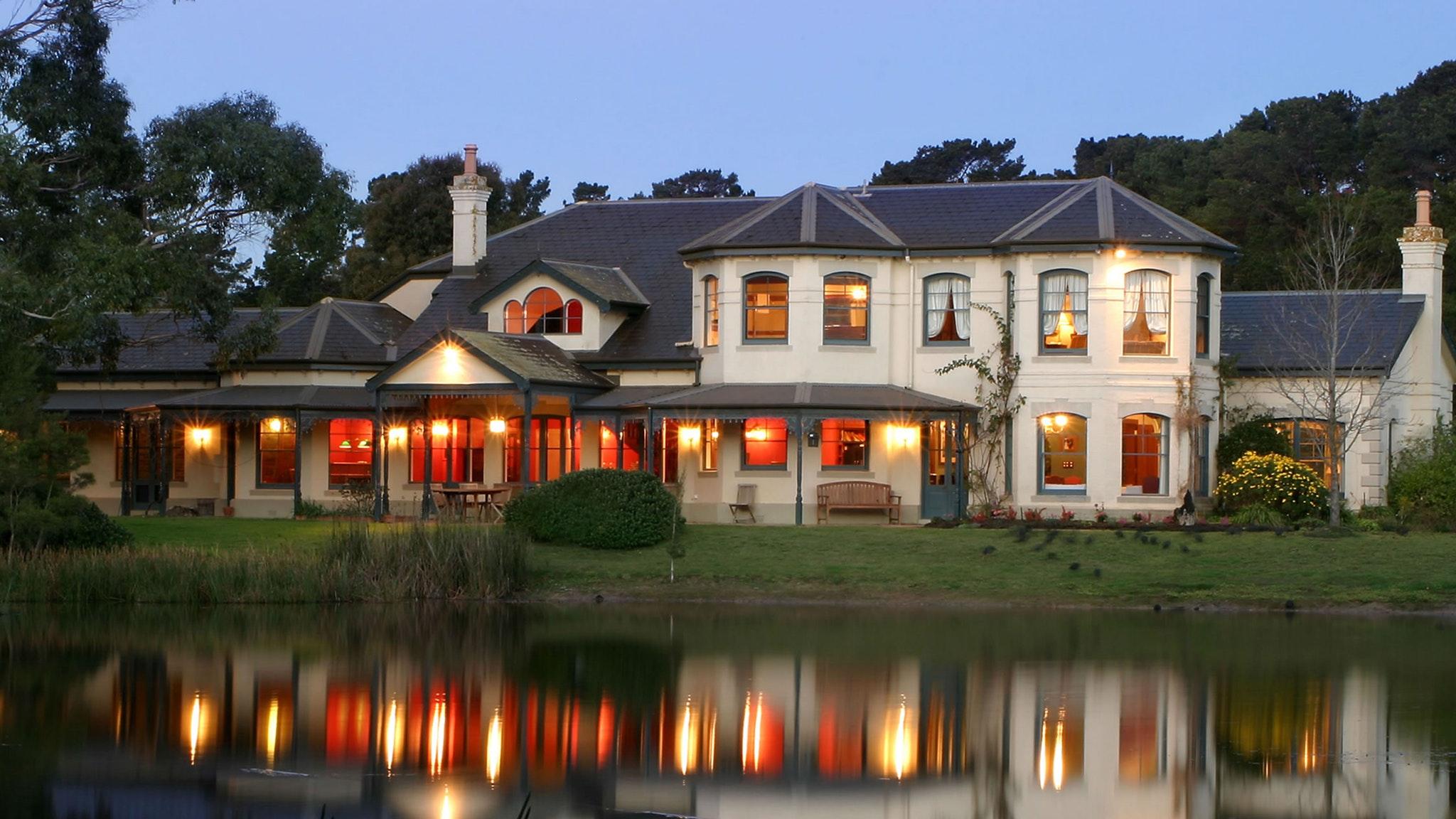 Woodman Estate Manor House Lake Lights