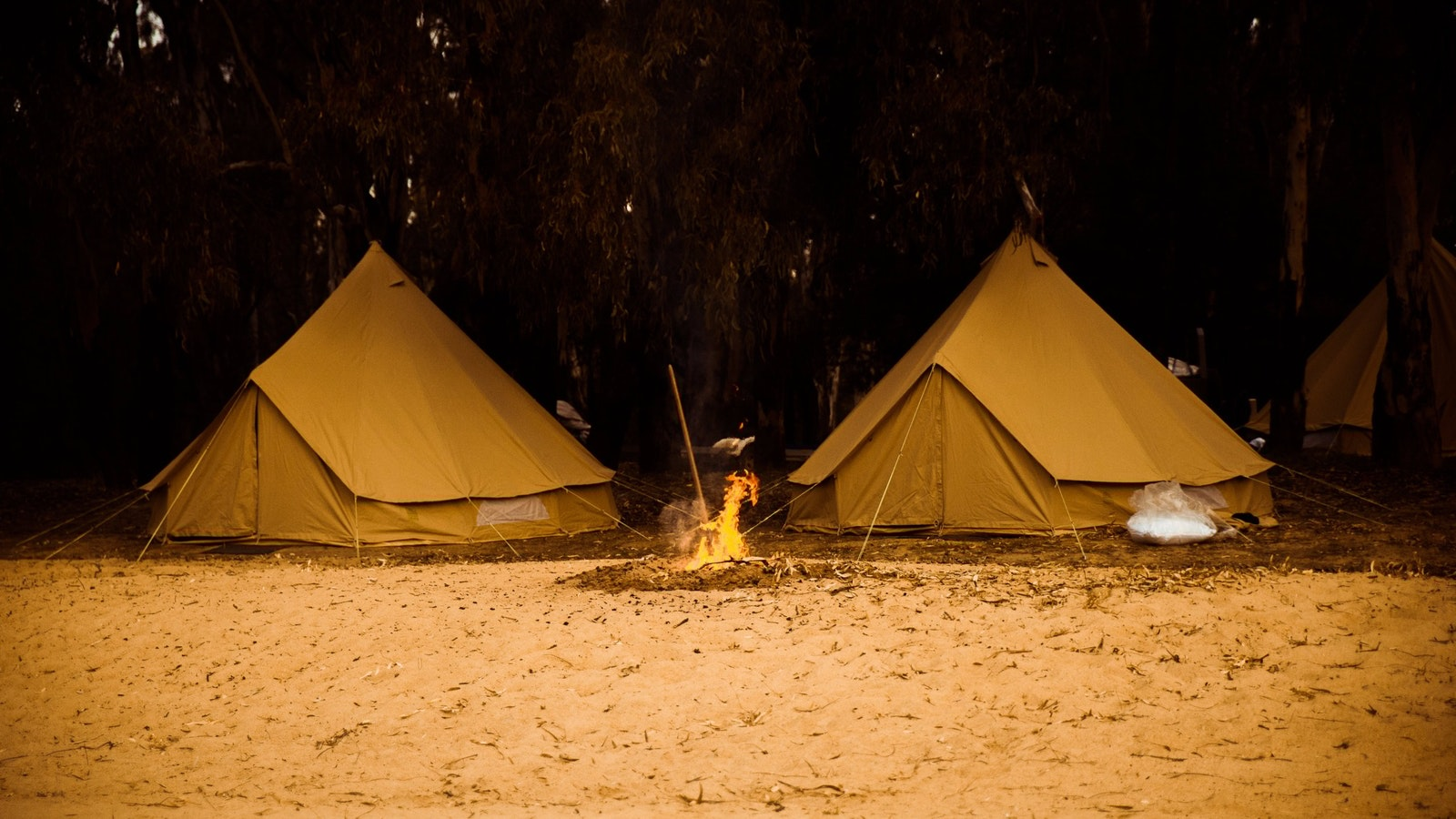 Bell tents, sandbar, fire - the best part after a long day.