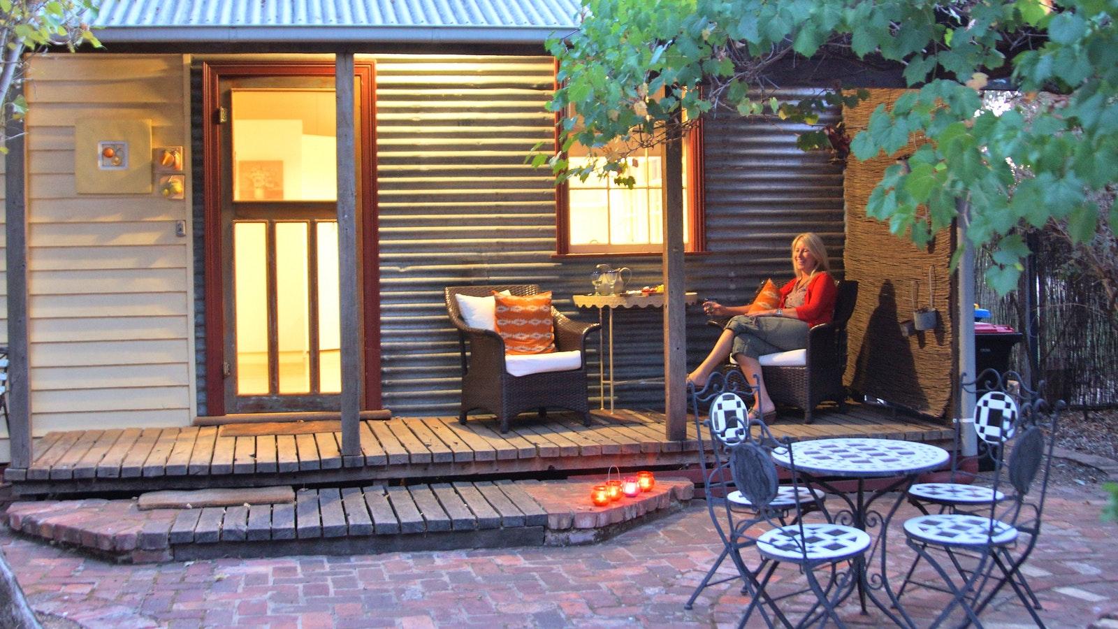 Relax on the gorgeous verandah overlooking the gardens