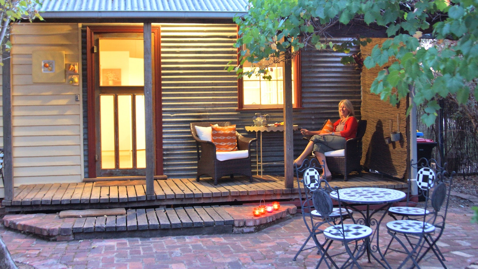 Relax on the gorgeous verandah overlooking the gardens