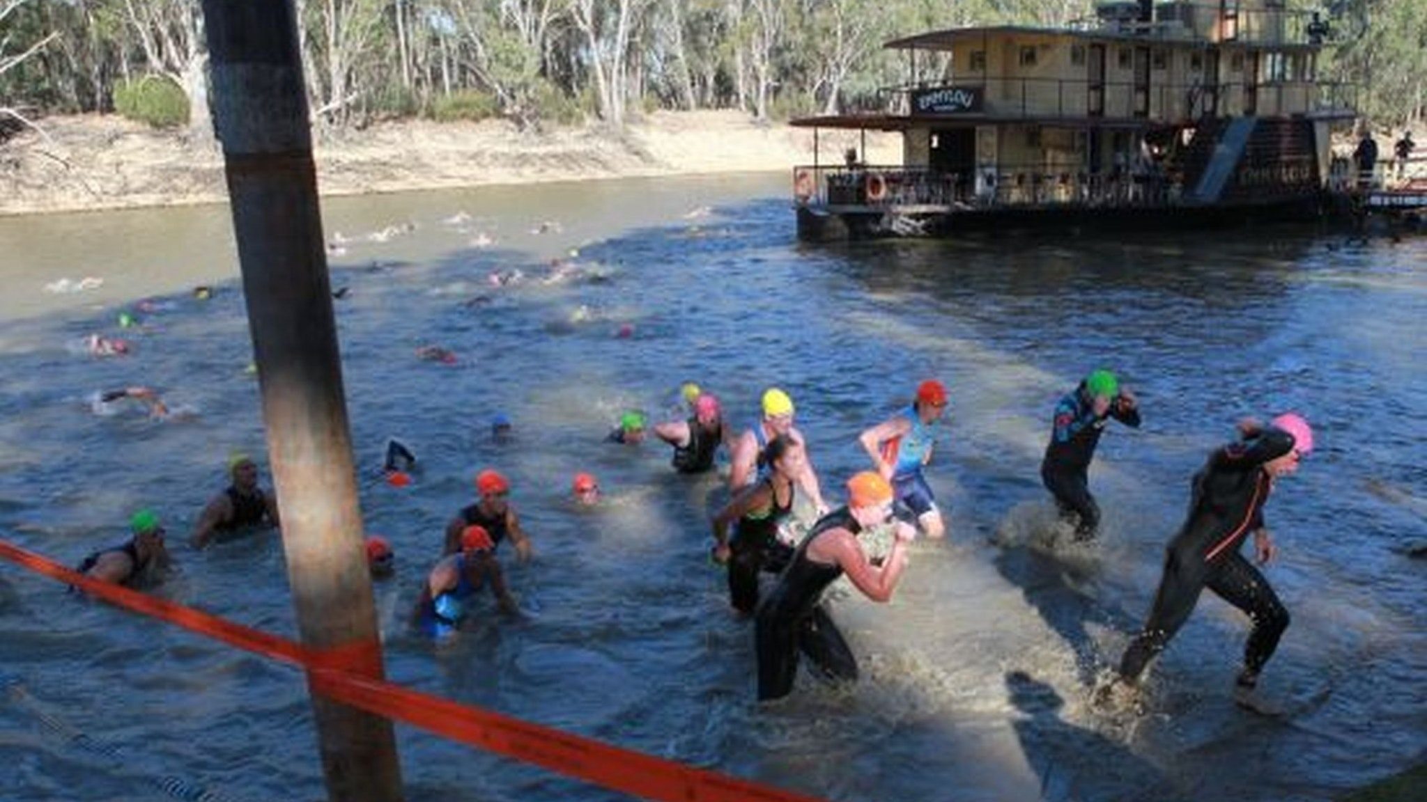 Swimmers leaving the Murray River