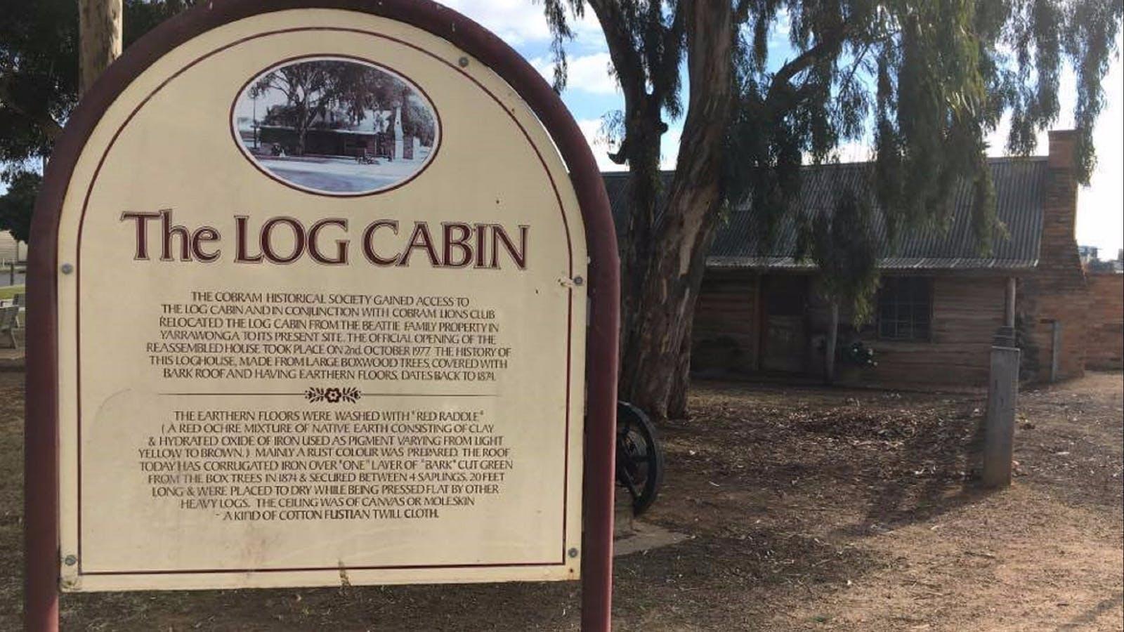 Sign at the Log Cabin