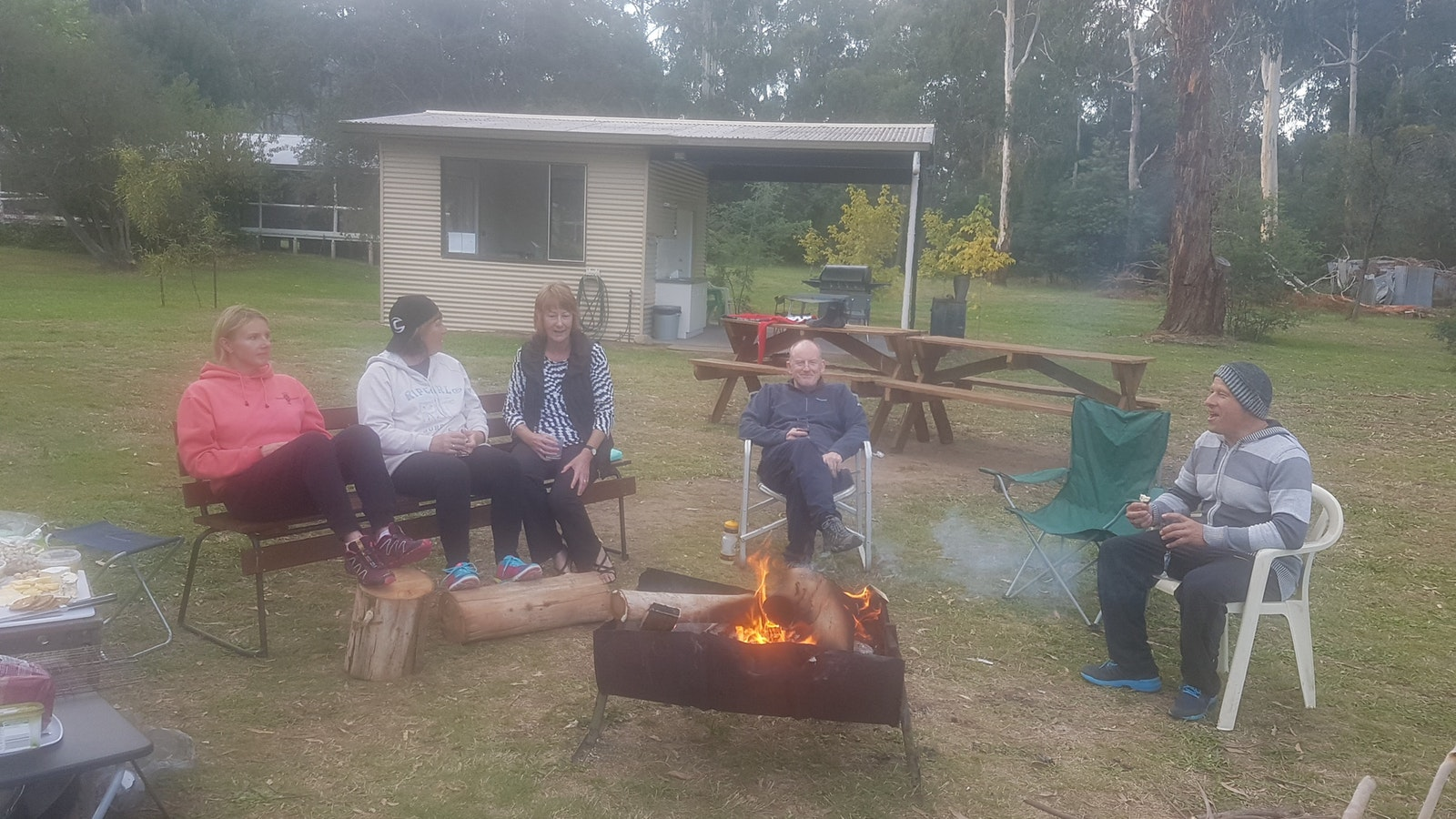 Wine and friends by campfire in the King Valley