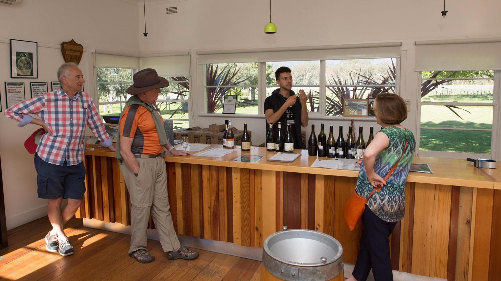 undertaking a wine tasting at the cellar door.