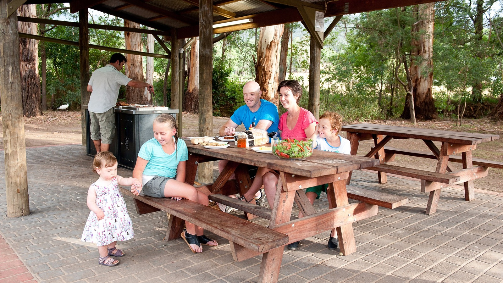 Family enjoying a BBQ in the BBQ area of BIG4 Yarra Valley Park Lane Holiday Park