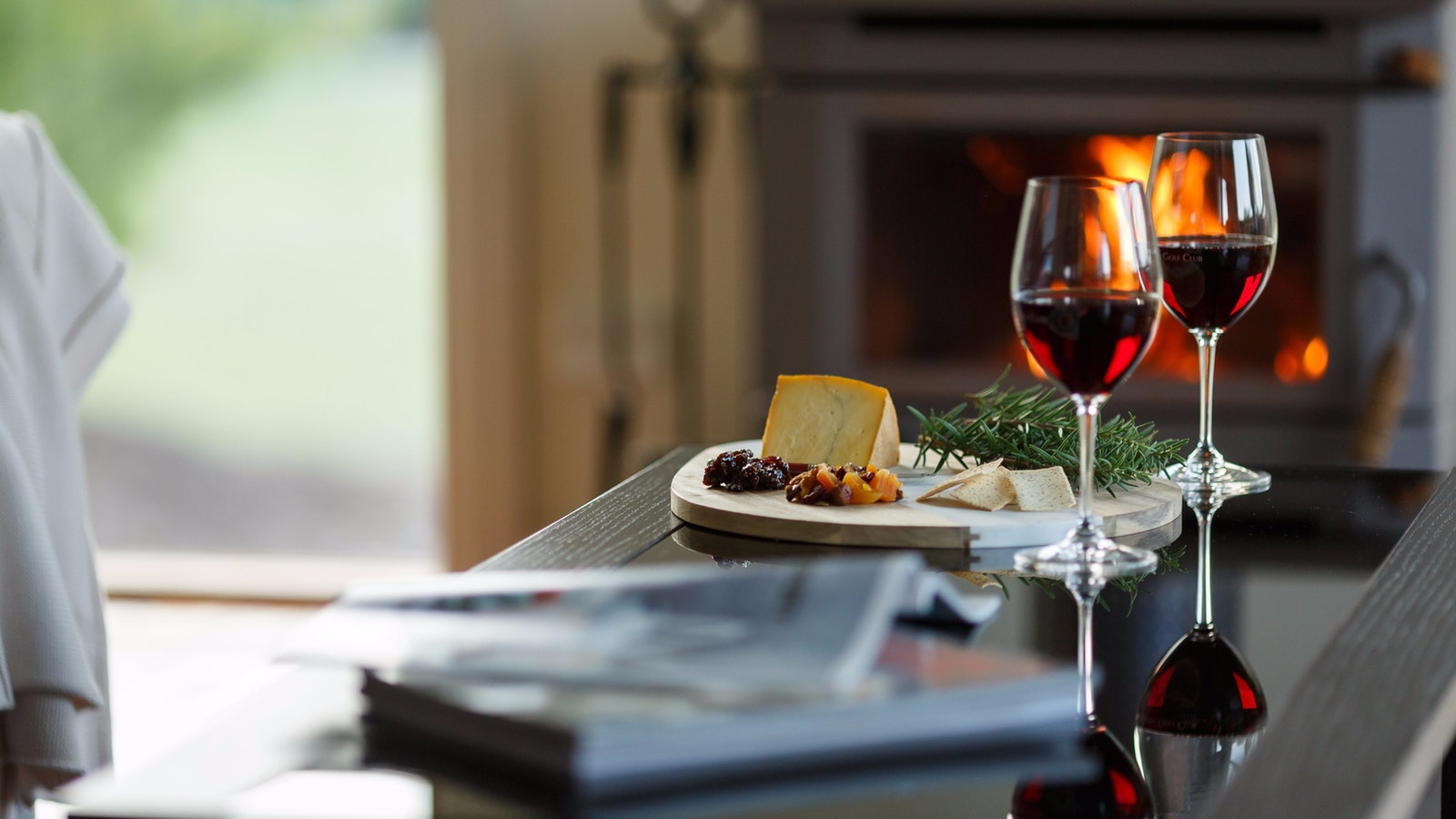 Cheese and wine by your personal fireplace