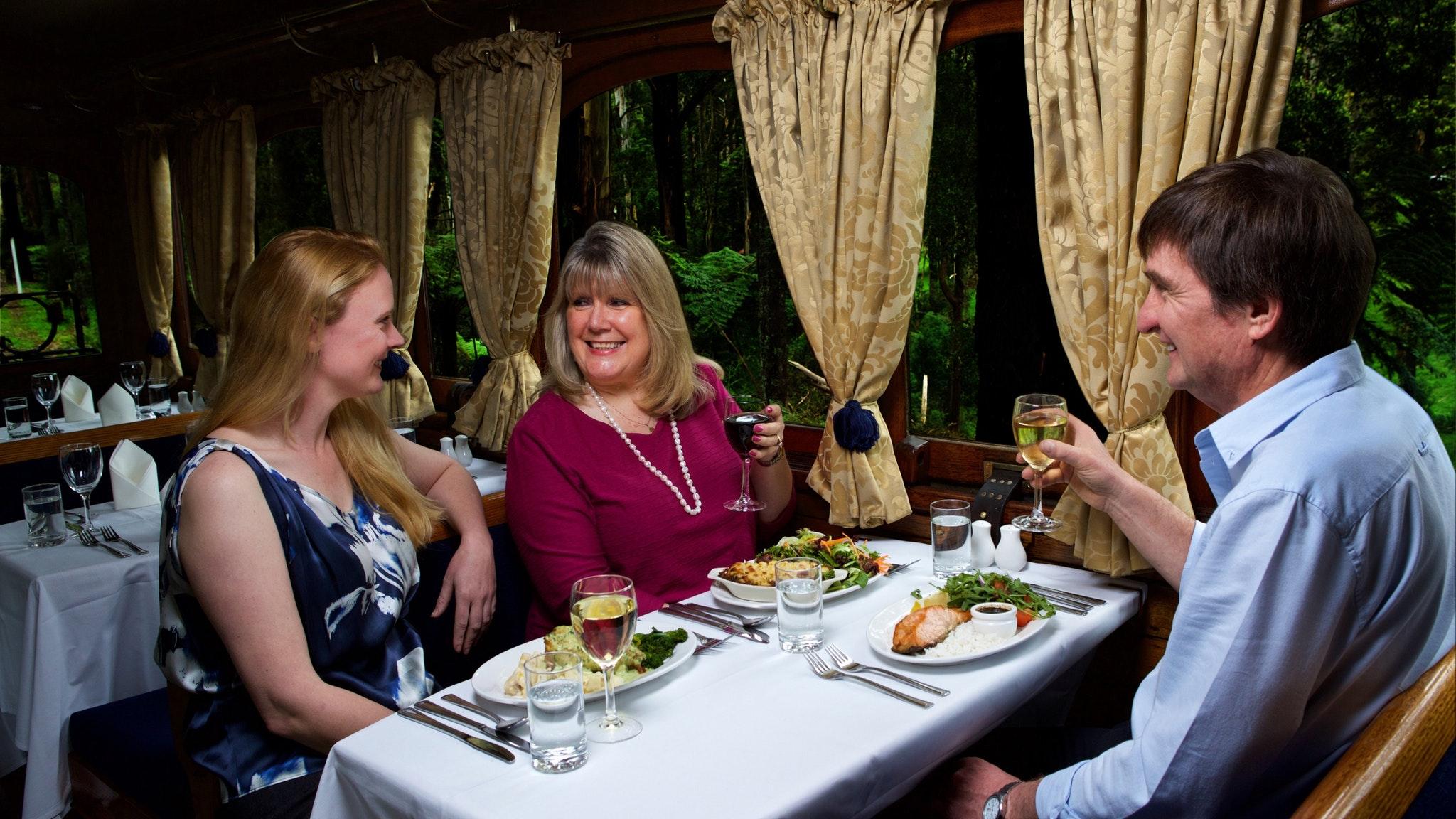 Visitors enjoying a meal aboard Steam & Cuisine After Dark