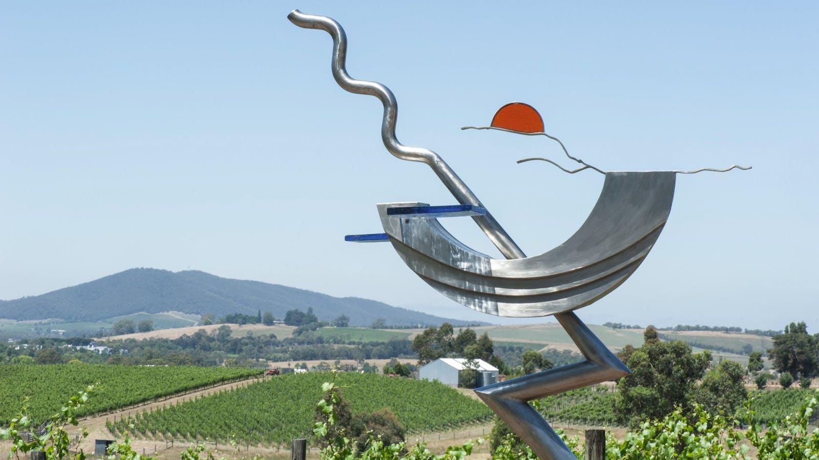 Stainless steel sculptures with vineyard views