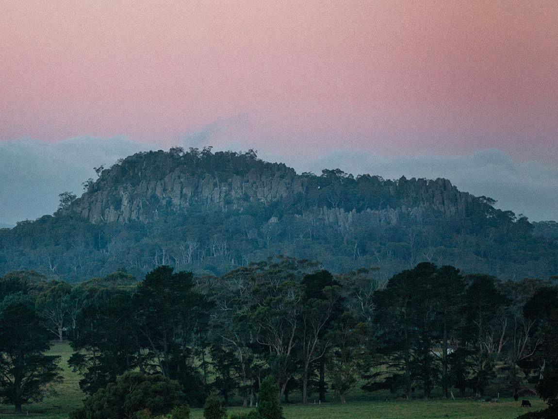 Hanging Rock at dusk, view from Newham, Daylesford and the Macedon Ranges, Victoria, Australia