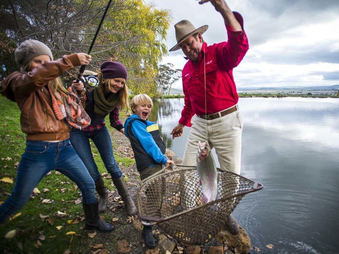 Family fishing at Tuki Trout Farm, Smeaton, Daylesford and the Macedon Ranges, Victoria, Australia