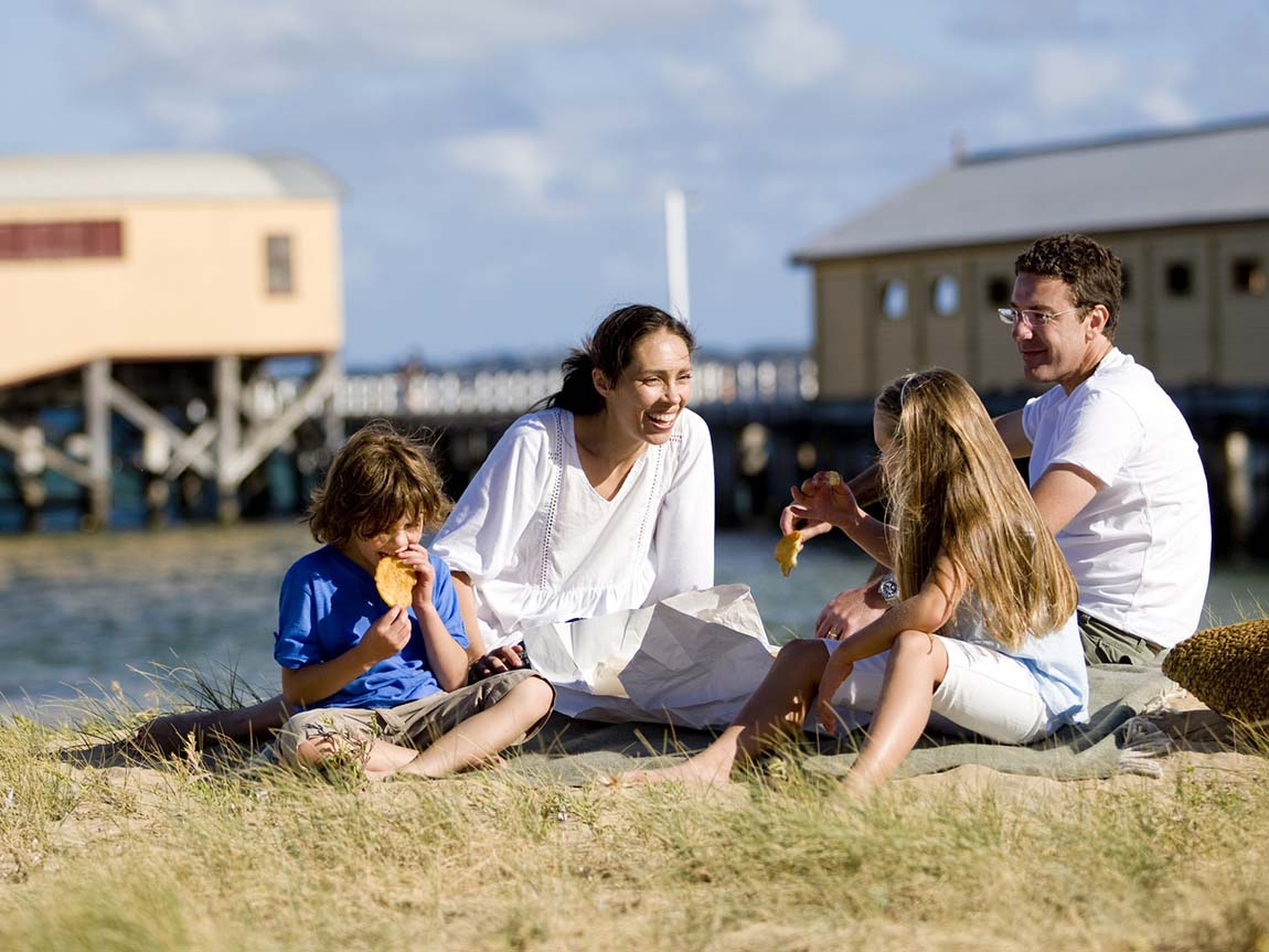 Family eating fish and chips in Queenscliff, Geelong and the Bellarine, Victoria, Australia