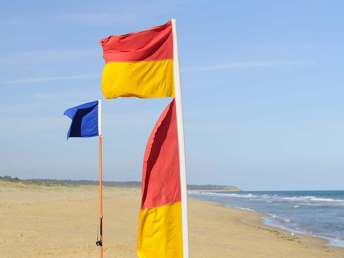 Lifesaving flags at Lakes Entrance Beach, Gippsland, Victoria, Australia