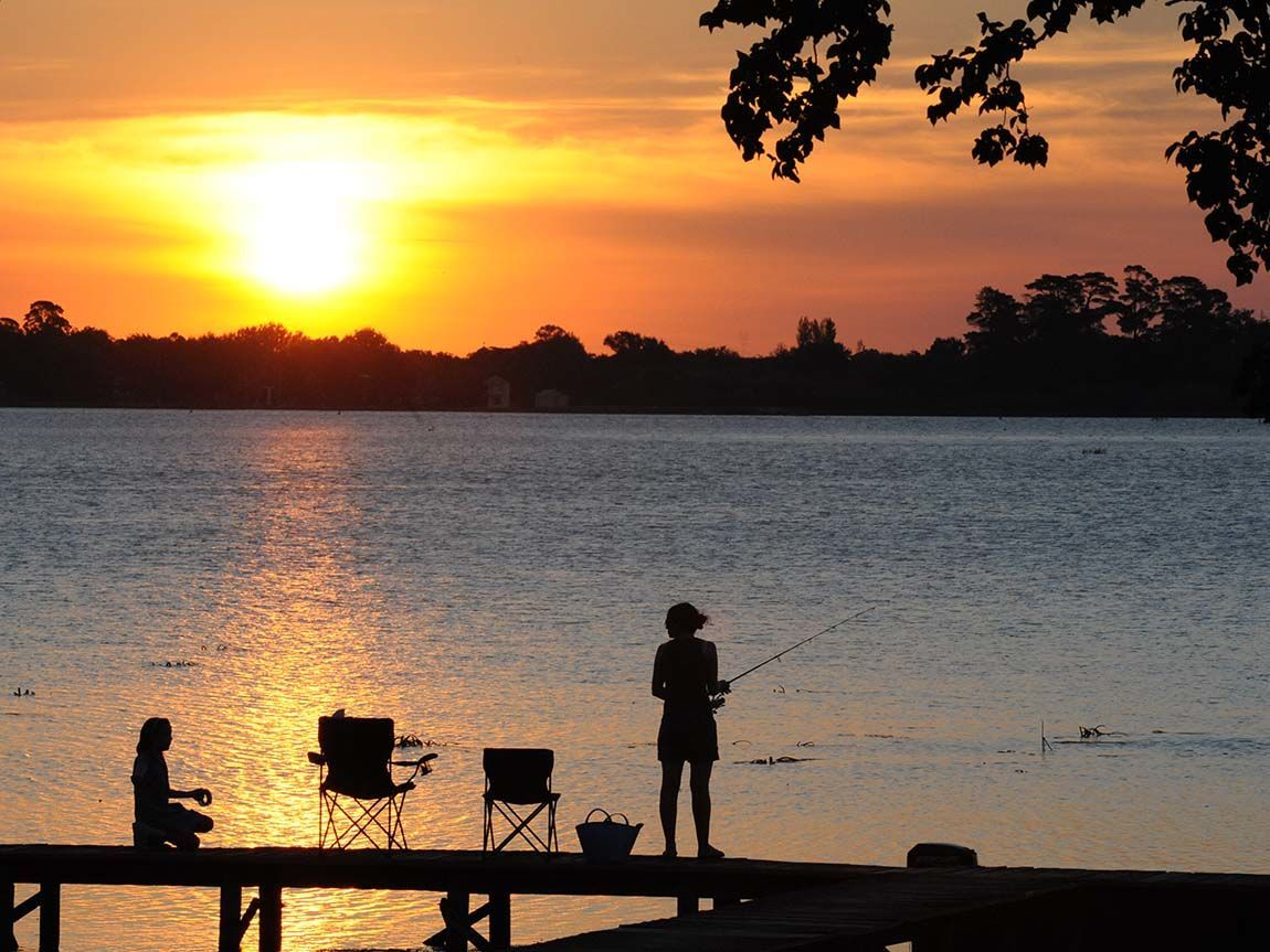 Fishing in Lake Wendouree at sunset, Ballarat, Goldfields, Victoria, Australia