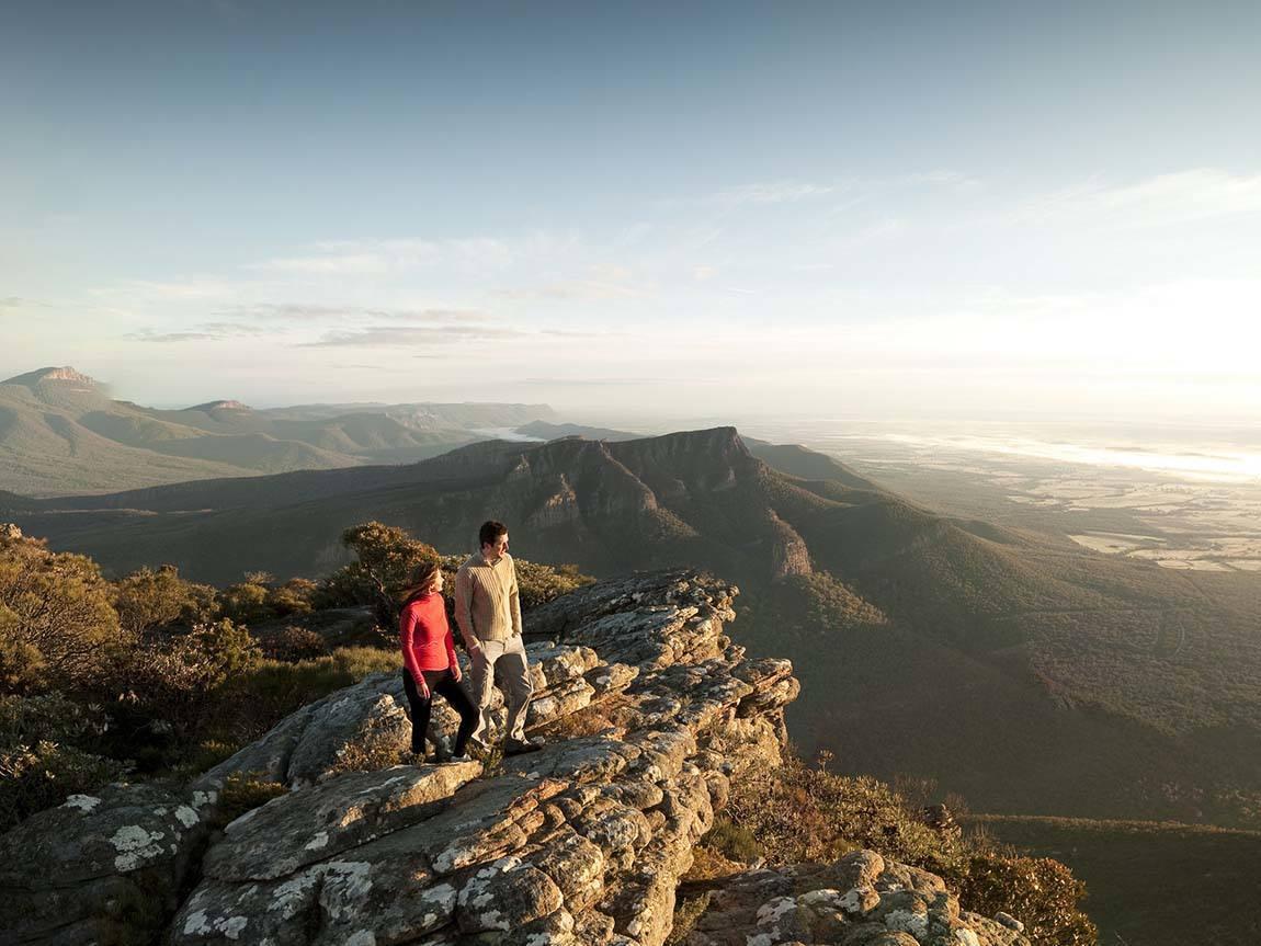 Couple at top of Mount William, Grampians, Victoria, Australia