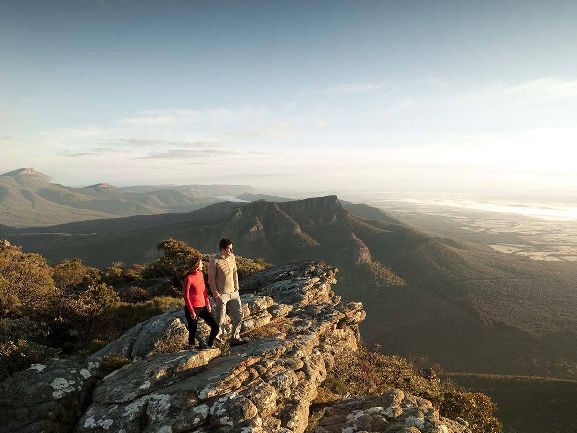 Couple at top of Mount William, Grampians, Victoria, Australia