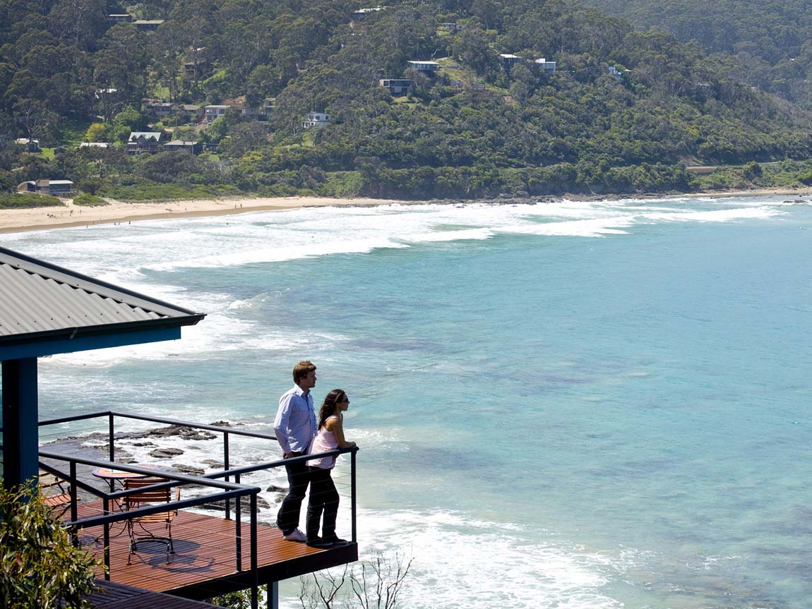 Couple on the balcony of the Wye River Deck House, Great Ocean Road, Victoria, Australia