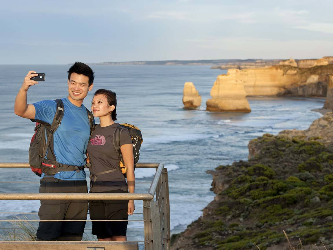 Couple at the Twelve Apostles, Great Ocean Road, Victoria, Australia
