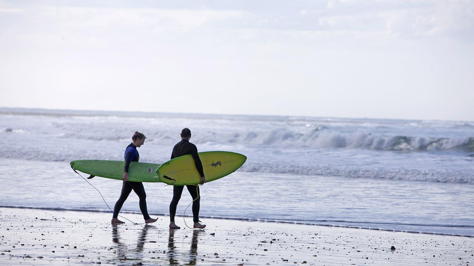 Surfers at Torquay Beach, Great Ocean Road, Victoria, Australia