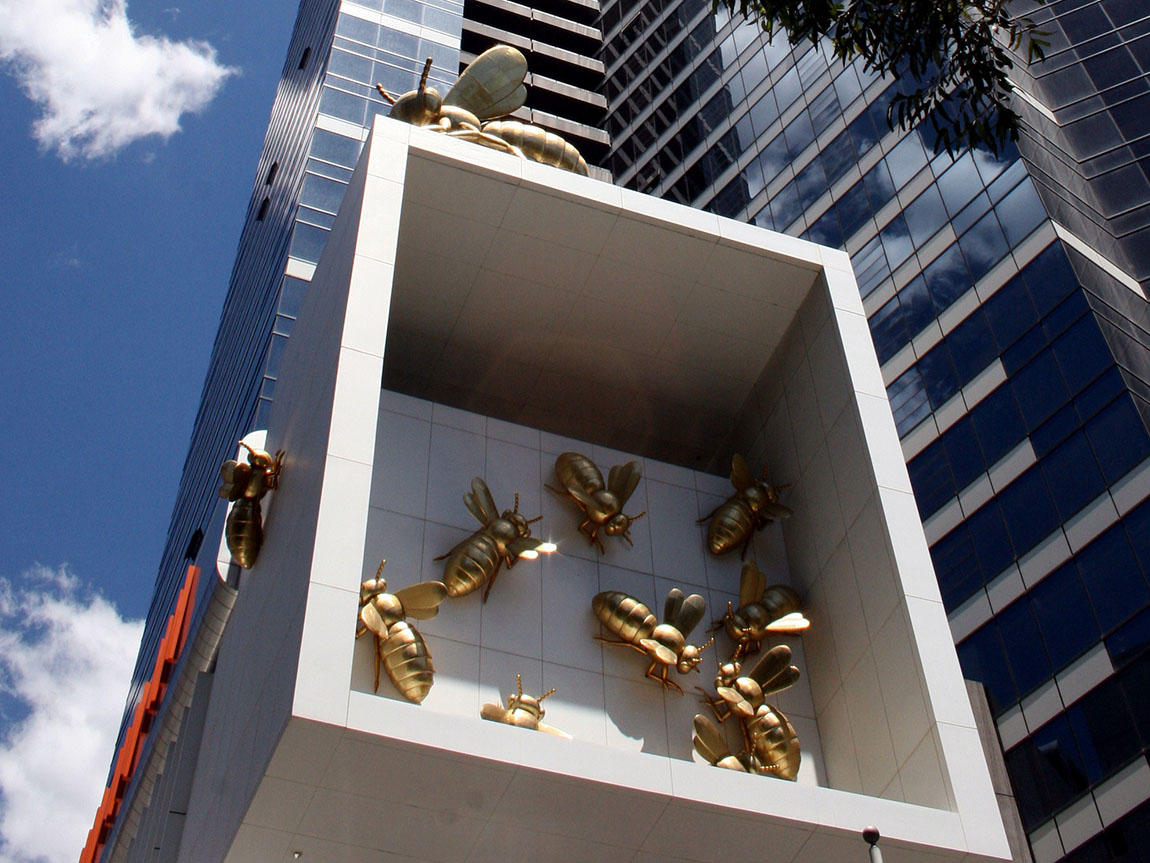 Sculpture of golden bees outside Eureka Tower, Southbank. Photo: Robert Mason.