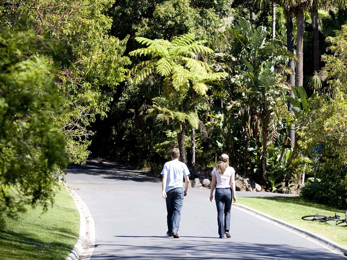 Couple walking through the Royal Botanic Gardens, Melbourne, Victoria, Australia