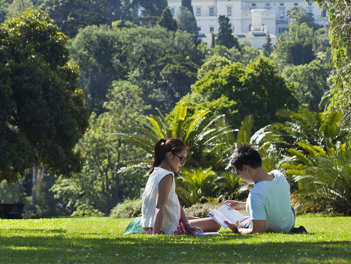 Couple relaxing in the Royal Botanic Gardens, Melbourne, Victoria, Australia