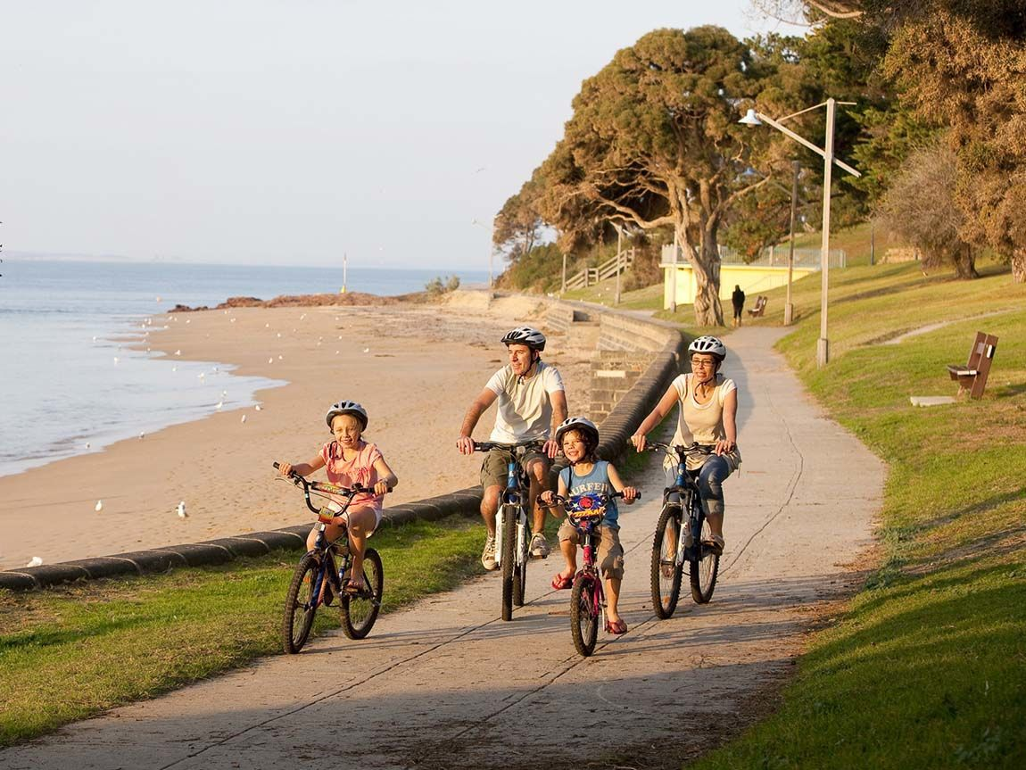 Cycling along Cowes foreshore, Phillip Island, Victoria, Australia