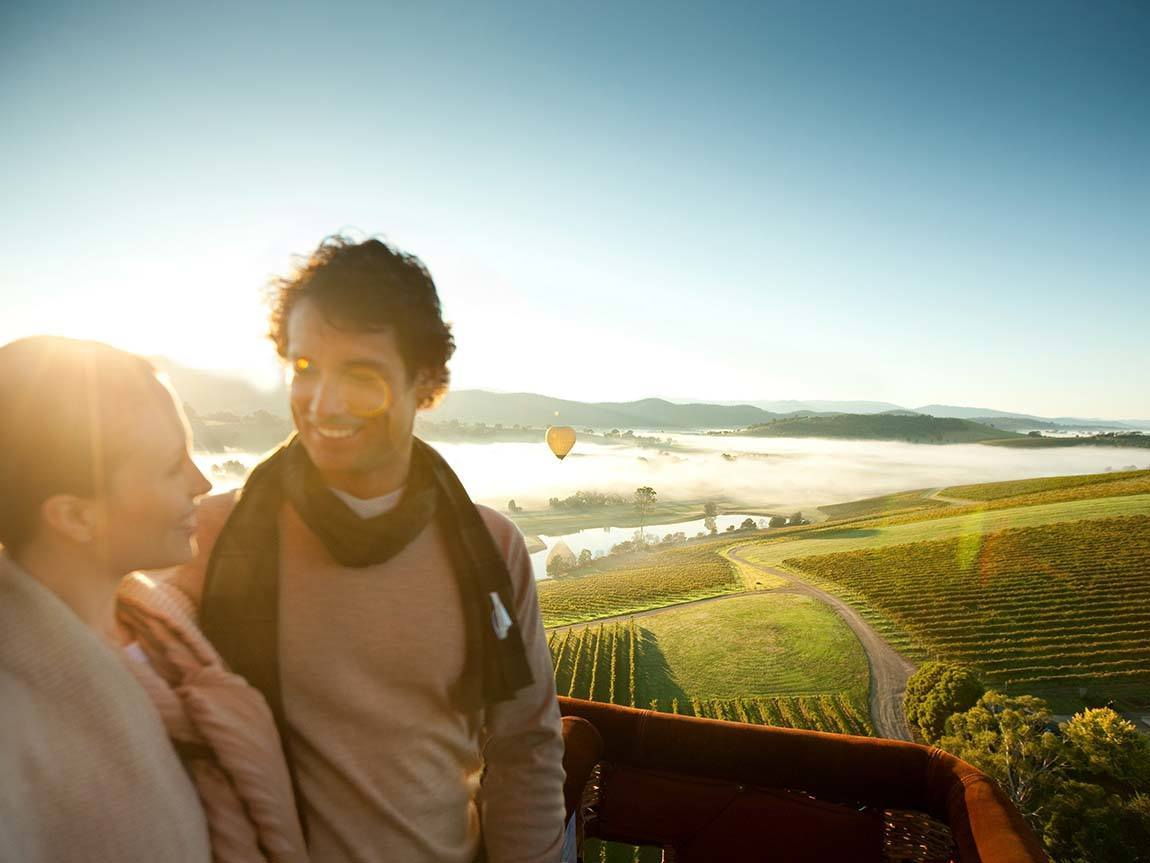 Couple in a hot air balloon over the Yarra Valley, Yarra Valley and Dandenong Ranges, Victoria, Australia